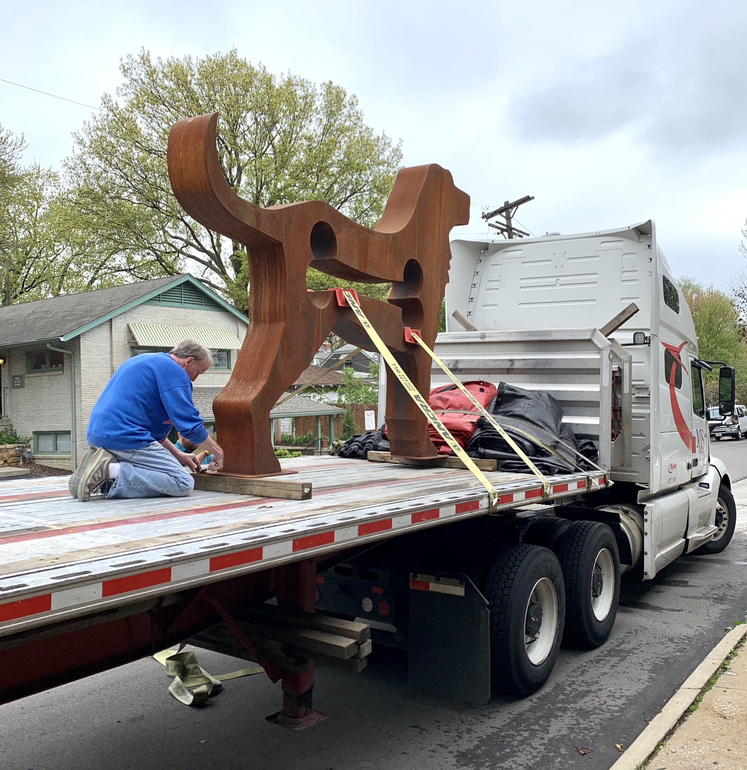 All About the Massive Dog Sculpture at Our New Location!